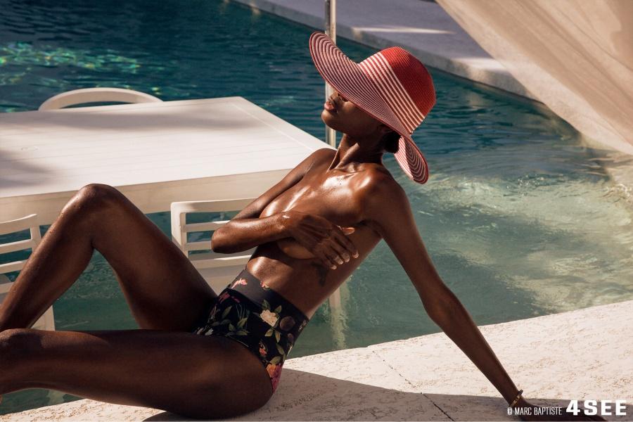 Female Model hat bottom pool photography by Marc Baptiste