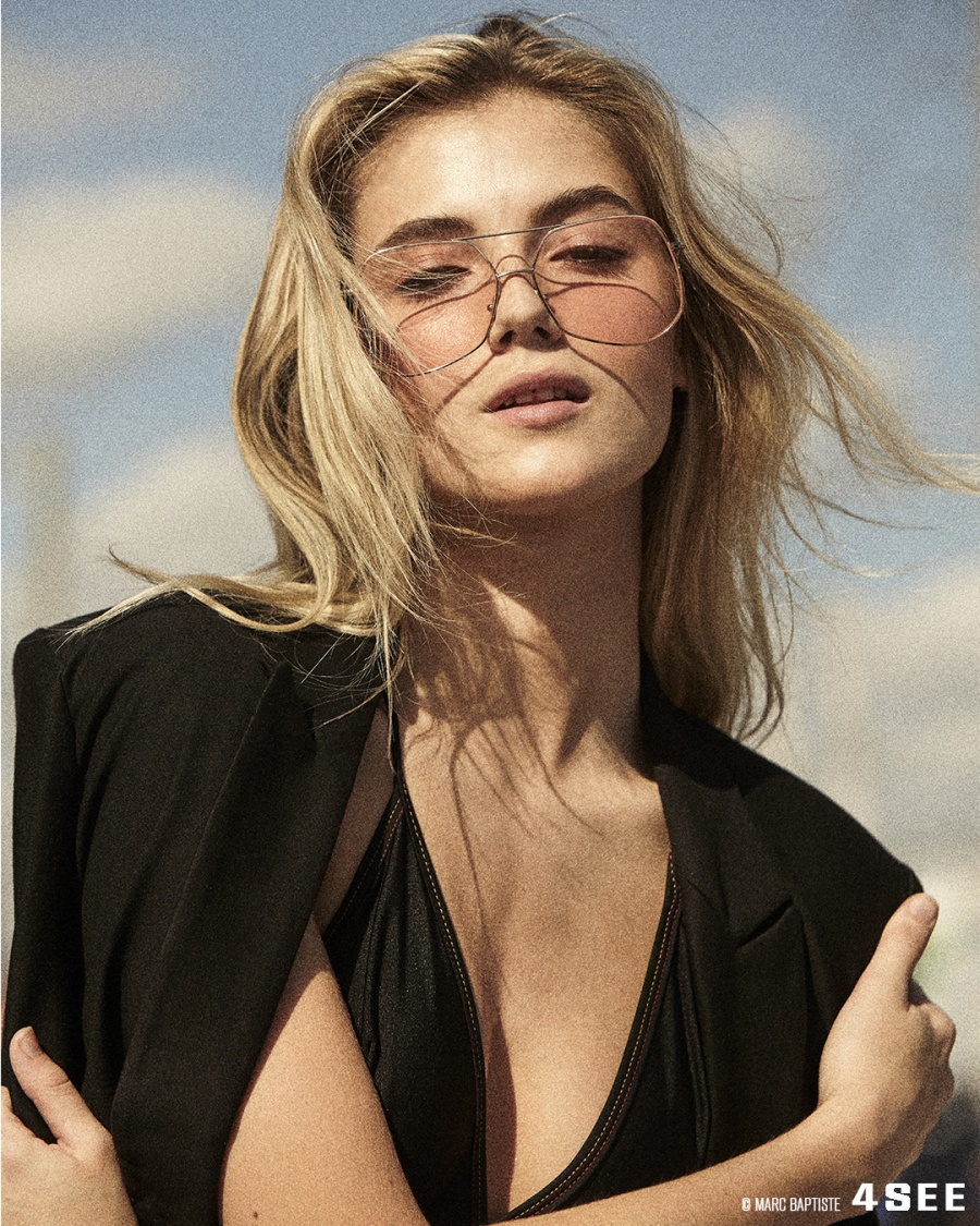 Leah Rose is wearing sunglasses by GREY ANT Mesh in Light Gold / Blush