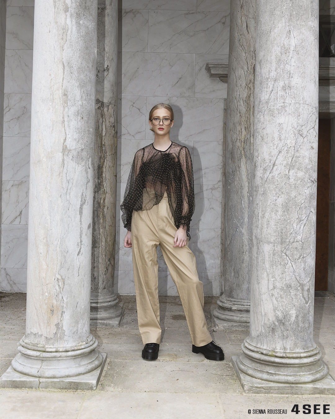 Scandi-Savvy Editorial featuring XAVIER GARCIA's black rimmed glasses Larios, with Munthe's black see through dress used as blouse, khaki pants by Envii