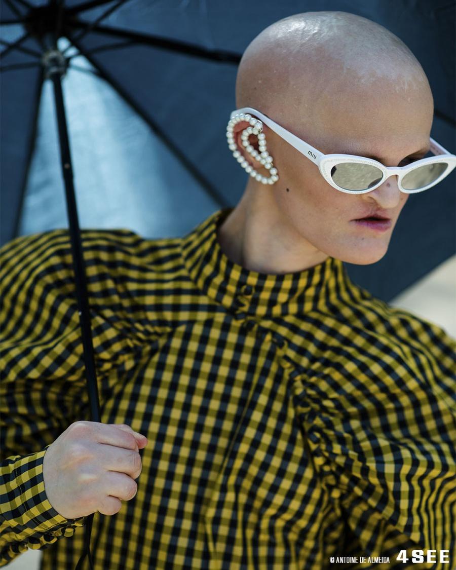 Eyewear Editorial with Melanie Gaydos // Sunglasses by miu miu MU09US // Dress by Rotate, Earrings by House of Danae